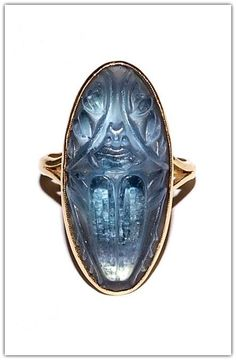 RENÉ LALIQUE | Gold, molded glass scarab ring (n.d.)