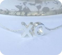 Enjoy this  XO necklace comes in silver or goldChain length is 18 inch with 1 inch extender