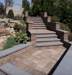 Step out of the box and create the walkway of your dreams. This beautiful walkway was created using Cambridge Pavingstones and Wallstones.