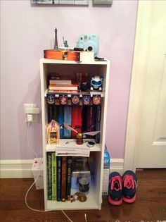 White bookshelf from Walmart with Harry Potter decorated