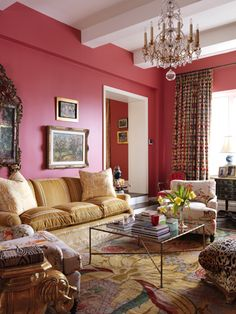 Note the gold velvet embellished sofa, the area rug, the leopard pouf, the elephant side table, the Chinoiserie mirror, bamboo motif coffee table, and, of course, the pink walls.  Elizabeth Bauer