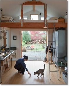 High-Ceiling Spaces: tiny one-car garage/shed which was converted to a house