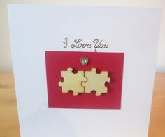 This I love you card is decorated with two wooden puzzles that fit together (: The I Love you card is 15x15 cm (6x6 in) in size and will come with a white envelope in a cellophane bag. As a special event there is an option to get the card with an organza bag, for a small additional charge. The inside of this I love you card has been left blank for your own couple message. All products used are of a high quality and all the work has been done by hand. Your order will be dispatched within 2…