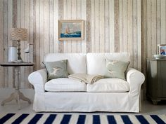A richly detailed Scandinavian panelled wood effect wallpaper pattern with the look of distressed and faded wood in pale natural colours.