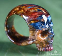 Beautiful hand carved pietersite gemstone skull ring by Skullis. http://www.skullis.com (Copyright: Skullis) #skulls