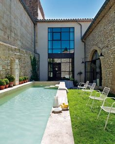 the windows are fabulous.  this appears to be one of the refurbished houses somewhere like Merida, MX..they generally have an enclosed area like this.  very private!  the walls look awesome and the lap pool running the length of the grassy area is begging you to take a moment and relax.