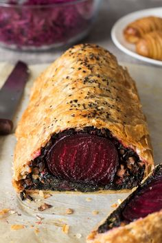 Beet Wellington with balsamic reduction - Lazy Cat Kitchen - - This impressive beet Wellington makes a beautiful Xmas centrepiece. It's goes really well with a simple balsamic reduction and usual trimmings. Veggie Recipes, Fall Recipes, Vegetarian Recipes, Cooking Recipes, Dinner Recipes, Dinner Ideas, Dinner Menu, Vegan Beet Recipes, Vegetarian Xmas