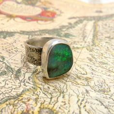 Blue Boulder Opal Ring with Wide Silver Reticulated Band. $170.00 USD, via Etsy.