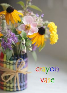 If you've got 10 minutes, a can, hot glue gun, and a pack of crayons, you can make this adorable vase. This craft is easy enough that your kids can help, too. For a more grown-up look, upgrade to colored pencils. Get the tutorial from Donuts, Dresses, and Dirt.