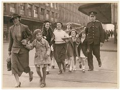 [Policeman helps woman with group of girls to cross a city street], ca. 1935, from Hood Collection part II / Sam Hood by State Library of New South Wales collection, via Flickr