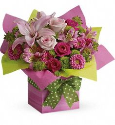 The Pretty Pink Present bouquet is a fantastic array of pink roses, asiatic lilies, matsumoto asters and alstroemeria, arranged with green button spray chrysanthemums in a pretty pink gift box. Order online. http://www.westerlyriflowers.com/westerly-flowers/telefloras-pretty-pink-present-372698p.asp?rcid=84&point=1