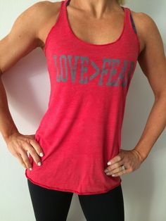 Love is greater than Fear every day of the week and twice on Sunday.  Feed what you love, starve what you fear and go in the direction of your purpose. Ladies tank is a sweet, soft, and light racerback cotton poly blend. Men's shirt is a buttery soft, slim fit 100% preshrunk ringspun cotton.**Proceeds from this shirt go to First Origin Scholarship Fund helping young people be the first in their family to go to college! Coming in early 2015!