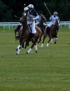 Polo players with umpire leading the field at Chester Racecourse - Roodee Challenge Polo Weekend