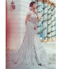Dripping with pearls and filigree, and with the minutest of ornate detailing our bridal couture is the perfect fit for the bride who wants… Pakistani Couture, Pakistani Bridal Dresses, Lehenga Gown, Saree Dress, Elan Bridal, Bridal Anarkali Suits, Pakistan Bridal, Eastern Dresses, Yellow Fashion