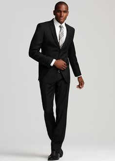 Black suit and grey patterned tie. Always a good...