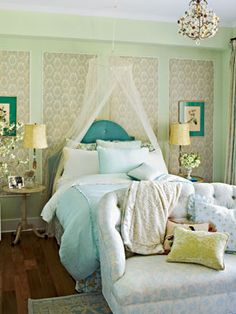 punches of #teal and #sofa at the foot of the #bed