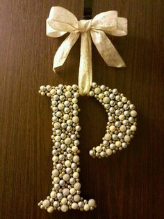'Wreath' made by gluing Christmas berries to a wood letter.