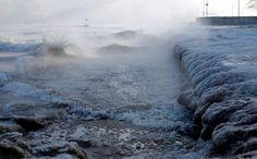 Ice forms as waves crash along Lake Michigan in below-normal temperatures near Oak Street Beach, Mon... - AP Photo/Kiichiro Sato