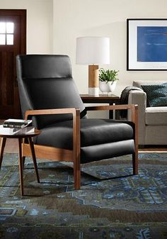 Inspired by Danish recliners popular in the 1950s and '60s, the Westport modern leather recliner features modern updates like comfortable cushions and a smooth reclining mechanism.