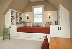 Attic or bonus room bedroom idea. Love the built ins and coziness of the space.