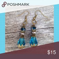 """Turquoise Crystal Earrings Turquoise Crystal beads and brass hang from brass ear hooks. Earrings are 1 1/2"""" long. Jewelry Earrings"""