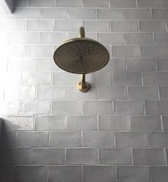 gold + gray, shower details. brass fixtures with gray tile. Luxe Living Interiors