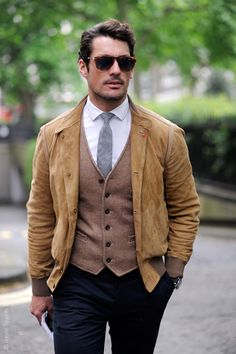 David Gandy's wardrobe utilizes high-quality, classic pieces that look flawless in every possible combination. Through the use of muted colors, he can mix and match a wide variety of trousers, shirts, ties and jackets and still look put-together. He also gets bonus points for the incorporation of the tweed vest into a casual look, creating a very interesting texture in juxtaposition with the suede jacket.