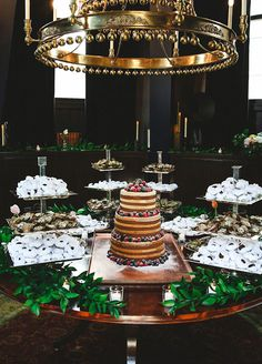 A chic wedding cake and desserts station.
