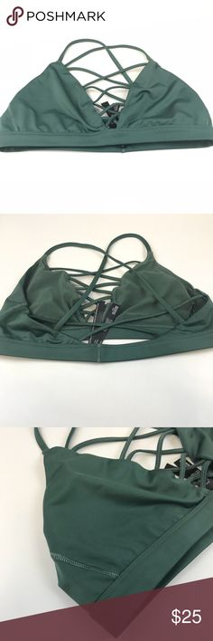 Victoria Secret Sports Bra Large Green Front Cage Victoria Sport Victoria's Secret Sports Bra. Large. No Wire/Wireless/Wire Free. A little darker green than pics perceive. Strappy Front Cage. Slip Over. Slots for removable padding but removable padding NOT included. Still lots of wear left in this. Victoria's Secret Intimates & Sleepwear Bras