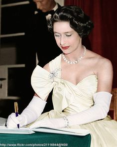 October 20 1956 Princess Margaret signing the Visitors Book during her visit to the European School at Arusha ,on the last day of her tour of Tanganyika