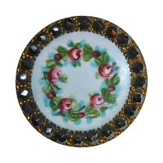 A gorgeous antique Victorian button with a beautifully enameled design and a sparkling border of cut steels.The gilt brass button outstanding with the