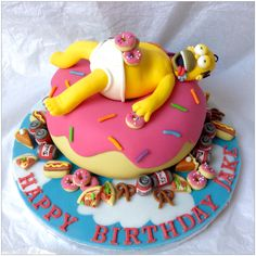 Over-indulgent Homer Simpson on a Giant Donut Cake. Feasting on donuts, Duff beer, pie, pretzels, pizza and hot dogs. Laura's  Cake Corner