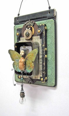 Assemblage Mixed Media  Title: Flutter  Artist: Carla Trujillo. Purchased a 'healing angel' metal art piece 1-4-13 at DeGrazia Gallery in Tucson AZ. Artist Jane Stern.