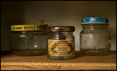 cleaning old glass jars: use olive oil or hot vinegar for the outside and baking soda and water for the inside