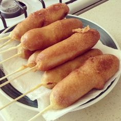 The Corn Dog - Mix 1c jiffy mix, 1c all purpose flour, 1 1/2c milk, 1/4c sugar, 1 tbsp honey, 1tbsp baking powder, 1tsp salt, 1egg beaten. Pour batter into tall glass. Skewer dogs (pat them dry) then dip them in the batter. Gently roll while dunking them in the hot oil. Cook about 2-3mins or until golden brown. Allow grease to drain onto paper towel, then eat.