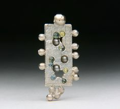 Float Cast Sapphires and Ball Bearing Silver & Copper Pendant by Jewels Curnow by jewelscurnow, via Flickr Cast Stone, Metal Jewelry, Metal Art, Wearable Art, Portland, Geometry, Brooches, Contemporary Art, It Cast