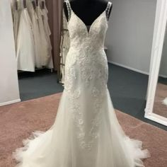 A sexy mermaid style, with a plunge neckline, lace motifs, hand beaded detail, illusion panels, delicate shoulder straps and finished with low illusion back Discount Designer Wedding Dresses, Mermaid Style, Dream Wedding Dresses, Bridal Boutique, Plunging Neckline, Shoulder Straps, Illusion, Townhouse, Delicate