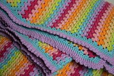 Rainbow crochet afghan with cool edging (Ravelry link)