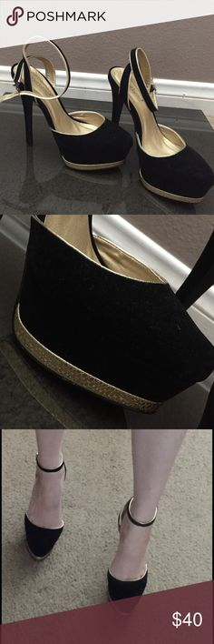 Black and Gold heels!! These black and gold heels are everything!!! They're very a very sexy pair of close toe heels. They are comfortable and the gold details are amazing! It stands out so much!! I've worn them once for a New Years party and they're too cute to just be in the shoe box in my closet. :) Shoe Dazzle Shoes Heels