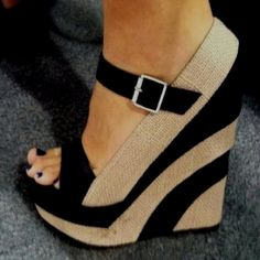 Nude and black wedges