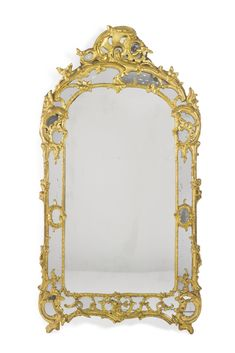 A Louis XV carved giltwood mirror mid-18th century. Sotheby's