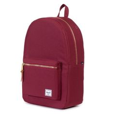 Maroon Herschel Backpack This back pack has gold hardware on it (zippers). There is a pouch for your laptop on the inside. Features classic red and white interior. There's a place for headphones and a small iPod pocket on the inside. There's a small pocket on the front. Only flaw is there's black markings on bottom inside of the back pack. Lightly used. Great quality back pack! Herschel Supply Company Bags Backpacks