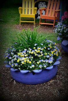 Painted tire flower pot.