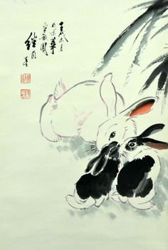 """Chinese Scroll Painting Manner of Liu Jiyou. Polychrome painting depicting a white mother rabbit and two black and white bunnies, with five calligraphy lines and two red seal marks, 23"""" W x 60"""" L."""