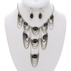 Draped with Elegance Silver and Black Statement Necklace, $26.00 Find fun fabulous fashion jewellery and statement jewlry at Strike Envy. #jewellery #jewlry StrikeEnvy.com