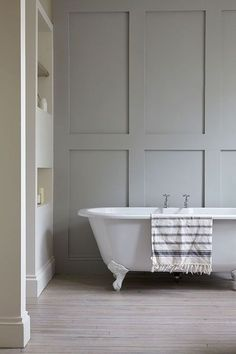 ULF G B☮HLIN • InteriorDesign - London Victorian, Clawfoot Tub, Light Gray Panelled Wall | Remodelista