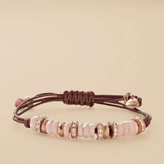 Perfect for everyday, this Peach Shell wrist wrap is a piece you won't be able to resist. A natural leather bracelet, complete with rose gold-tone and faceted peach-hued shells; create a fresh look that's perfect for layering.