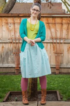 Green tee, turquoise cardigan, yellow wooden bead necklace, light blue vintage button skirt, pink OTKs, cognac Steve Madden Troopa boots.