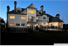 Sun setting over gorgeous 15,000 sq. ft. mansion