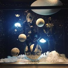 """DE BIJENKORF, Rotterdam, The Netherlands, """"Listen Hendrik... We live on a blue planet that circles around a ball of fire next to a moon that moves the sea... And you don't believe in miracles?"""", photo by Rick Bakker, pinned by Ton van der Veer Window Display Design, Shop Window Displays, Store Displays, H Design, Store Design, Vitrine Design, Behind The Glass, Museum Displays, Retail Windows"""